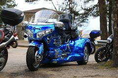 Blue tricycle Honda 1800 Gold Wing in nature. Front view royalty free stock photography