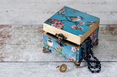 Blue Trinket Box. Beuatiful decoupaged trinket box on a rustic background Stock Image