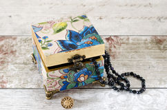 Blue Trinket Box. A gorgeous hand made trinket box with bronze feet and hasp on a shabby chic background Royalty Free Stock Photography