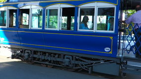 Blue trolley car sightseeing going up the mountain Tibidabo in Barcelona stock video footage
