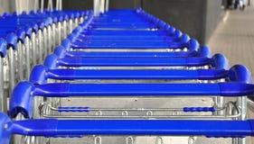 Blue trolleys Stock Image