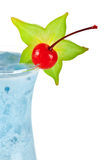 Blue tropical cocktail with coconut cream Royalty Free Stock Photo