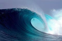 Blue tropical ocean surfing wave. Perfect tropical blue ocean surfing wave in Sumatra Royalty Free Stock Images