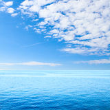 Blue tropical sea and clouds on sky beach. Stock Images