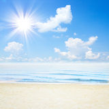 Blue tropical sea and clouds on sky beach. Stock Photos