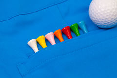 Blue trousers  and golf equipments Royalty Free Stock Images