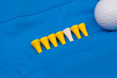 Blue trousers  and golf equipments Stock Photography