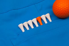 Blue trousers  and golf equipments Royalty Free Stock Image