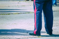 Blue trousers with a red stripe on the military man. The stripes on the pants royalty free stock photo