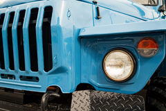 Blue truck front close-up with radiator grille and headlights Stock Photos