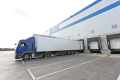 Blue truck and Gates of Big distribution warehouse Stock Photos