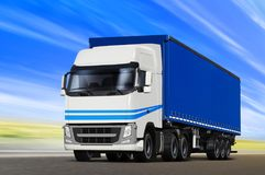 Blue truck goes on the way Royalty Free Stock Photography