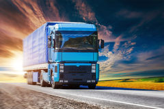 Blue truck on highway. Blue truck is driving on the sunset highway Stock Photos
