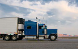 Blue truck moving on a highway stock photography