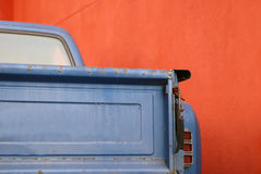Blue truck red wall Stock Images