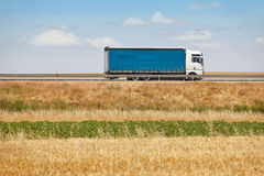 Blue truck on the road. Delivery cargo logistic. Royalty Free Stock Images