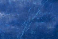 Blue truck tarpaulin Stock Images