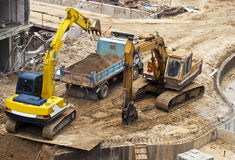 Blue Truck Working at Construction Site Stock Image