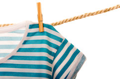 Blue tshirt hanging on a rope clothesline Royalty Free Stock Image