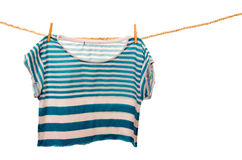 Blue tshirt hanging on a rope clothesline Royalty Free Stock Photo