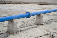 Blue pipe. Near a house Royalty Free Stock Photos