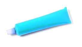 Blue tube of paint Stock Images