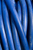 Blue tubing. Reel of blue hose pipe Royalty Free Stock Photo