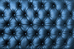 Blue tuffted leather with buttons royalty free stock images