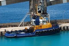 Blue tug boat Stock Image