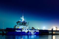 Blue tug ship. Moored at the pier in Riga, Latvia stock image