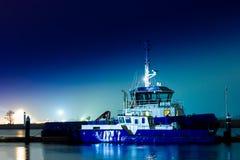 Blue tug ship Stock Image