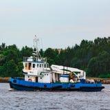 Blue tug ship underway Royalty Free Stock Images