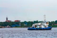 Blue tug ship underway Stock Photos