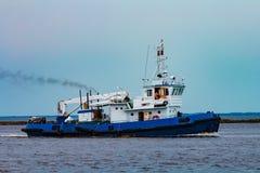 Blue tug ship underway Stock Images