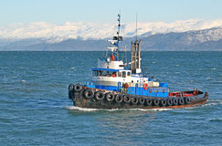 Blue tugboat in the bay Royalty Free Stock Images