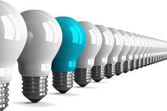 Blue tungsten light bulb and many white ones, perspective view Stock Photos