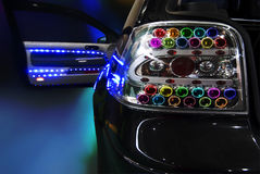 Blue tuning. Black tuning car with a lot of Light Bulb Royalty Free Stock Photography
