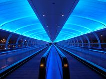Blue Tunnel. Blue airport walkway royalty free stock images