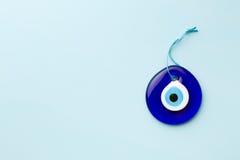 Blue turkish eye. On blue background Royalty Free Stock Photo