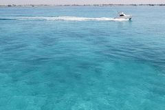 Blue turquioise Caribbean sea fishing boat Stock Photos