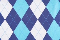 Blue and turquoise background fabric. Blue and turquoise background texture of some plaid fabric Royalty Free Stock Image