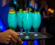 Blue Turquoise Cocktail Welcome Drink at a corporate gala dinner. Banquet event Stock Photo
