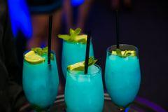 Blue Turquoise Cocktail Welcome Drink at a corporate gala dinner. Banquet event stock images
