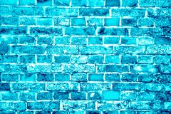 Blue turquoise or cyan brick wall painted with different tones and hues as seamless pattern texture background royalty free stock images