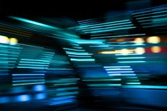 Blue color lights on the move. Blue and turquoise lights of urban city surrounding moving and blurred by motion royalty free stock photos