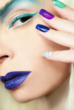 Blue turquoise makeup and manicure. Stock Photo