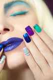 Blue turquoise makeup and manicure. Stock Photos