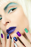 Blue turquoise makeup and manicure. Royalty Free Stock Photography