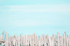 Blue or turquoise oceanic background with a fence of driftwood f Stock Photo