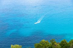 Blue turquoise sea background. Aerial Blue turquoise sea water pattern background with a fishing boat. Aegean Sea, Skiathos, Greece, 2018 royalty free stock photography